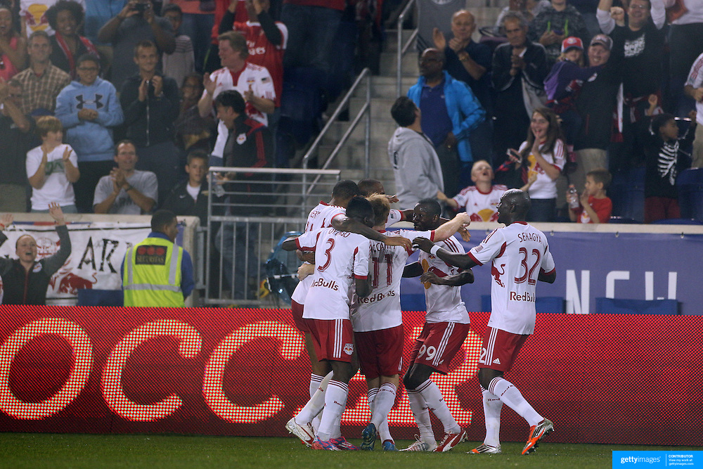 Bradley Wright-Phillips, New York Red Bulls, celebrates with team mates after completing his hat trick, during the New York Red Bulls Vs Seattle Sounders, Major League Soccer regular season match at Red Bull Arena, Harrison, New Jersey. USA. 20th September 2014. Photo Tim Clayton