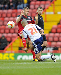 Bristol City's Liam Kelly battles for the ball with Bolton Wanderers' Darren Pratley - Photo mandatory by-line: Joe Meredith/JMP - Tel: Mobile: 07966 386802 13/04/2013 - SPORT - FOOTBALL - Ashton Gate - Bristol - Bristol City V Bolton Wanderers - Npower Championship