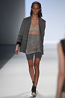 Joan Smalls walks the runway wearing Richard Chai Spring 2011 Collection during Mercedes Benz Fashion Week in New York on September 9, 2010