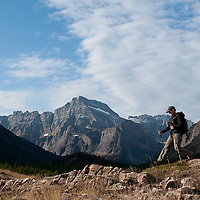 woman hiking in glacier national park, crown of the continent, hiker many glacier vallery, grinnell mountain