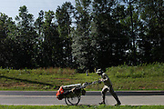 """DACULA, GA – JUNE 7, 2014: Karl Bushby travels along Highway 124, several miles east of Atlanta, Georgia. Bushy walks about 20 miles a day, and has admitted that his quest to get permission to travel through Russia is a long shot. """"If I skip Russia and just start walking through China, I've failed.""""<br /> <br /> Karl Bushby is trying to complete the longest walk in history. Unless the Russians stop him. As a 45 year-old Brit, Bushby been traveling around the world on foot since 1998. In the most recent leg of his journey, Bushby is walking to Washington, D.C. to petition the Russian Embassy to lift a visa ban that prohibited him from continuing his hike through Russia."""