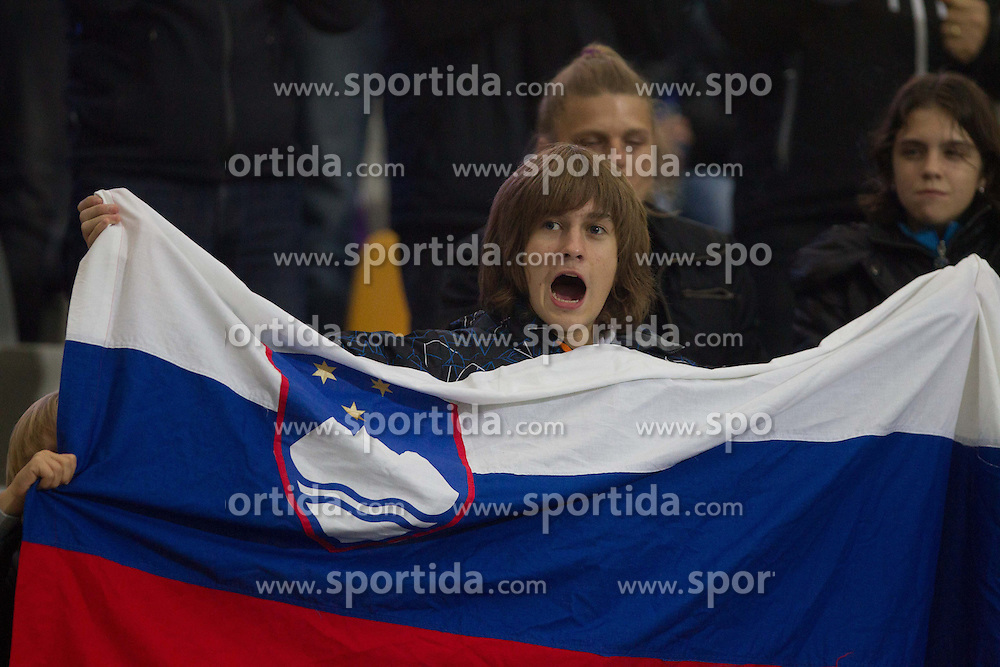 Fans of Slovenia celebrate during football match between National teams of Slovenia and Cyprus in 3rd Round of Group E of FIFA World Cup 2014 Qualification on October 12, 2012 in Stadium Ljudski vrt, Maribor, Slovenia. (Photo By Vid Ponikvar / Sportida)