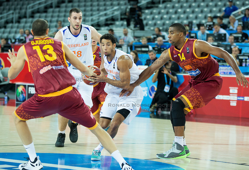 06-09-2015 CRO: FIBA Europe Eurobasket 2015 Nederland - Macedonie, Zagreb<br /> Leon Williams of Netherlands vs Stojan Gjuroski of Macedonia and Richard Hendriks of Macedonia during basketball match between Netherlands and Macedonia at Day 2 in Group C of FIBA Europe Eurobasket 2015, on September 6, 2015, in Arena Zagreb, Croatia. Photo by Vid Ponikvar / RHF