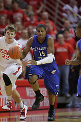 17 November 2010: Jon Ekey reaches under and steals the ball from Kenny Moore during an NCAA basketball game between the Tennessee State Tigers and the Illinois State Redbirds at Redbird Arena in Normal Illinois.