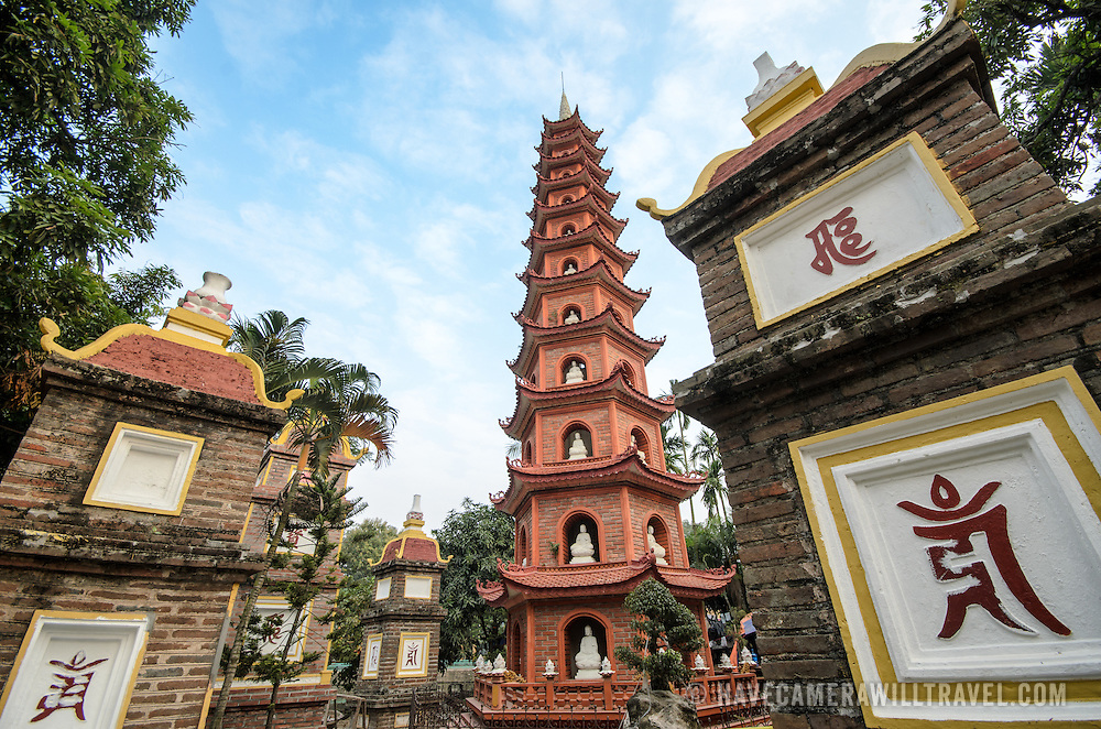 A tower with small white statues at Tran Quoc Pagoda on a small island on West Lake (Ho Tay). Originally built in the 6th century on the banks of the Red River, a changing course of the river forced the pagoda to be relocated in 1615 to Golden Fish (Kim Ngu) islet on the lake.