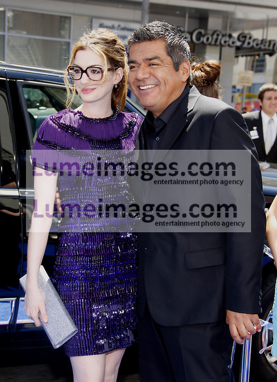 HOLLYWOOD, CA - APRIL 10, 2011: Anne Hathaway and George Lopez at the Los Angeles premiere of 'Rio' held at the Grauman's Chinese Theater in Hollywood, USA on April 10, 2011.