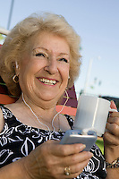 Senior Woman Drinking Coffee and Listening to Music