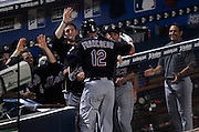 ATLANTA - AUGUST 3:  Outfielder Jeff Francoeur #12 of the New York Mets gets high fives from teammates after hitting a 9th inning, go ahead home run to take the lead for good during the game against the Atlanta Braves at Turner Field on August 3, 2010 in Atlanta, Georgia.  The Mets beat the Braves 3-2.  (Photo by Mike Zarrilli/Getty Images)