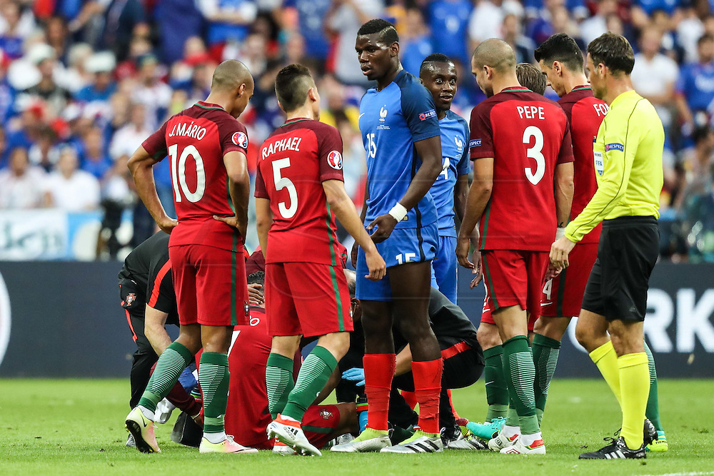 Raphael Guerreiro from Portugal and Paul Pogba from France chat during the match against France. Portugal won the Euro Cup beating in the final home team France at Saint Denis stadium in Paris, after winning on extra-time by 1-0.