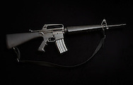 A Colt AR-15 with a 30 round clip, a flash suppressor and a bayonet mount.  Flash suppressor and bayonet mounts were the details of guns that came to be known as  assault rifles and were banned in 1984 with Brady Law that expired in 2004. An AR-15 was the type of semi-automatic assault rifle Adam Lanza used in the Sandy Hook school massacre. Since the mass killing, gun sales have went up and AR -15s are selling out of stock.