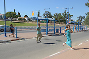 UNSPECIFIED, ISRAEL - JULY 17, 2014: Israelis run to take cover in a shelter as a Red Alert Siren is heard in the Southern city of Sderot, on July 17, 2014. Photo by Gili Yaari.