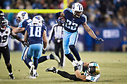NASHVILLE, TN - DECEMBER 31:  Derrick Henry #22 of the Tennessee Titans runs the ball and breaks the tackle from Paul Posluszny #51 of the Jacksonville Jaguars at Nissan Stadium on December 31, 2017 in Nashville, Tennessee.  The Titans defeated the Jaguars 15-10.  (Photo by Wesley Hitt/Getty Images) *** Local Caption *** Derrick Henry; Paul Posluszny
