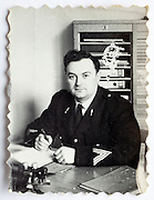 officer soldier behind desk France 1960