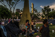 Dozens of families of the Ava Guarani ethnic group camp outside National Congress in Asuncion, Paraguay, Friday, Dec., 15, 2017. Holders of the purest forms of the Guarani language,  they decided to camp in the capital to demand reparation after being  evicted from their land and having their houses burned for alleged land grabbers. Paraguay today is trying to promote a positive image of Guaraní. But centuries of subjugation have rendered it a second class language in the minds of many Paraguayans. (Dado Galdieri for The New York Times)