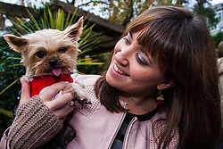 Hampstead Heath, London, October 26th 2014. Dogs rescue and re-homing charity All Dogs Matter hold their annual Halloween fancy dress dog walk on Hampstead heath. PICTURED: Artie, a yorkshire Terrier and her owner Elizabeth.