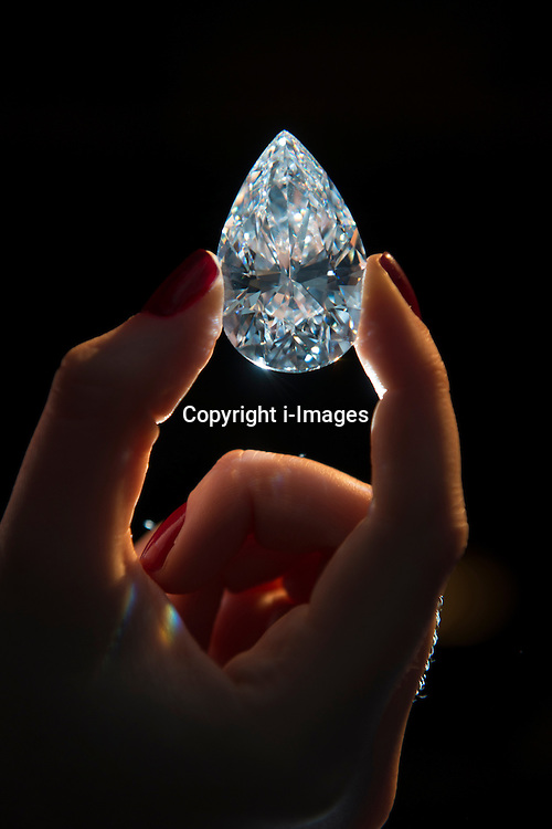 The Largest D colour Flawless Diamond ever to be offered for auction at Christie's Geneva on May 15th. Image shows a Christie's employee admiring the D Colour Type IIA Flawless Diamond - estimate on request, London, UK, March 13, 2013. Photo by: i-Images...