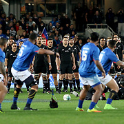 Sony Bill Wiliams, Jerome Kaino and their All Blacks teamates look on as Manu Samoa issues its Siva Tau challenge.  The New Zealand All Blacks defeated Manu Samoa 15's 83-0 at Eden Park, Auckland, New Zealand.  Photo by Barry Markowitz, 6/16/17