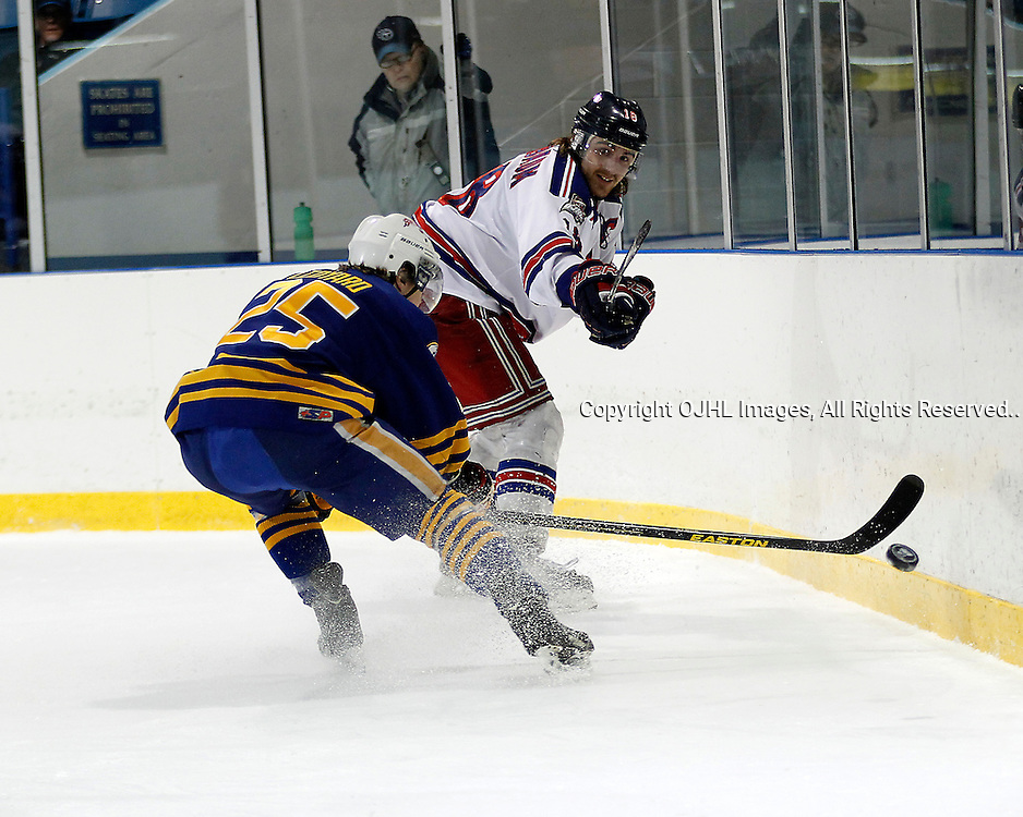 NORTH YORK, ON - Mar 15 : Ontario Junior Hockey League, Playoff Series  Action, 2nd round game between, Buffalo Jr Sabres and the North York Rangers. Dana Tenenbaum #18 of the North York Rangers clears the puck out of the zone during second period game action..(Photo by Tim Bates / OJHL Images)