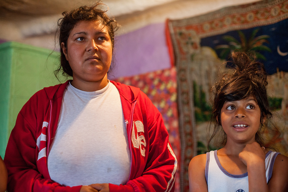 Mother Adriana Nae and her daughter in their house located in the Roma area of Frumusani.