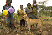 Rural children in Tanzania play with balloons