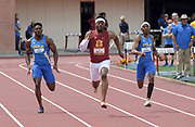 Eric Allen Jr. of Southern California (center) defeats Leon Powell (left) and Seth Holloway of UCLA to win the 200m in 20.80 during an NCAA college dual meet in Los Angeles, Sunday, April 28, 2019.