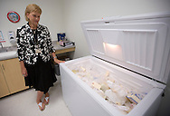Director Jean Drulis stands by an open freezer that holds incoming donated milk at the Mother's Milk Bank of Iowa in Coralville, Iowa on Friday, August 17, 2012. .