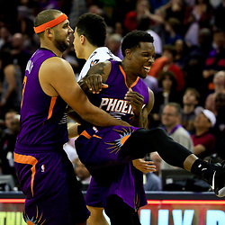 Nov 4, 2016; New Orleans, LA, USA; Phoenix Suns guard Eric Bledsoe (2) celebrates with forward Jared Dudley (3) after winning a game in overtime against the New Orleans Pelicans at the Smoothie King Center. The Suns defeated the Pelicans 112-111 in overtime. Mandatory Credit: Derick E. Hingle-USA TODAY Sports