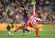 FC Barcelona's Xavi Hernandez (l) and Sporting de Gijon's Alberto Rivera during La Liga match.August 31 2009.