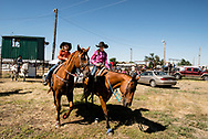 Sisters Draya and Bre Elle Wacker, Ingomar, Montana, annual rodeo