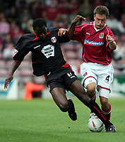 Fotball<br /> Foto: SBI/Digitalsport<br /> NORWAY ONLY<br /> <br /> Northampton v Leyton Orient<br /> Coca-Cola Football League 2<br /> Sixfields Stadium.<br /> 28/08/2004<br /> <br /> Leyton Orient's Jabo Ibehre and Northampton's Ashley Westwood (c) battle it out for the ball.