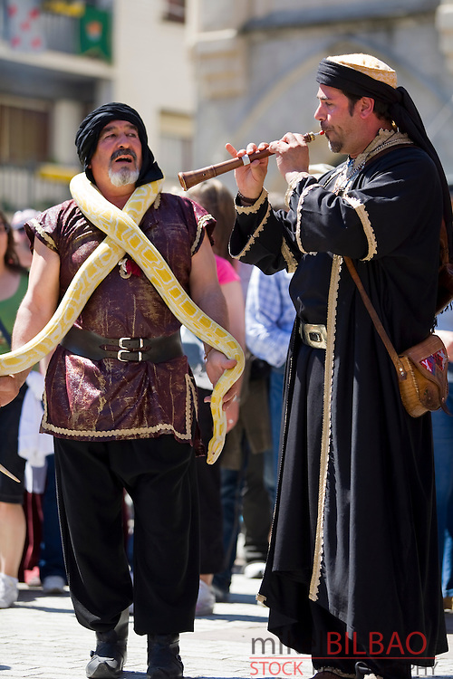 Arab musicians and street artist with a snake.<br /> Medieval Fair. Balmaseda, Biscay, Basque Country, Spain.