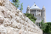 Israel, Jerusalem, Hagia Maria Sion Abbey (Dormition Abbey) is a Benedictine abbey in Jerusalem on Mt. Zion just outside the walls of the Old City near the Zion Gate. It was formerly known as the Abbey of the Dormition of the Virgin Mary, but the name was changed in 1998 in reference to the church of Hagia Sion that formerly stood on this spot.