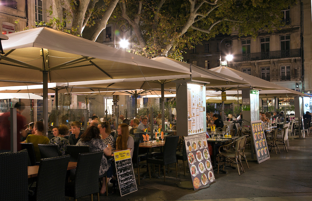 Cafes line the Place de L'Horloge in Avignon, France.