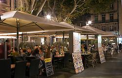 Cafes line the Place de L'Horloge in Avignon, France.