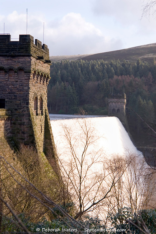 Water flowing over the Derwent Dam during heavy rains and flooding, Peak District, Derbyshire, UK