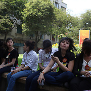 Young Vietnamese women relax in a park area in Ho Chi Minh City, Vietnam. 3rd March 2012. Photo Tim Clayton