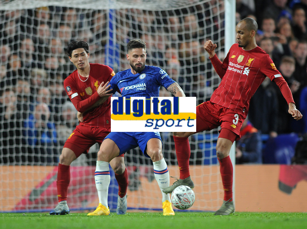 Football - 2019 / 2020 Emirates FA Cup - Fifth Round: Chelsea vs. Liverpool<br /> <br /> Takumi Minamino and Fabinho of Liverpool and Olivier Giroud of Chelsea, at Stamford Bridge.<br /> <br /> COLORSPORT/ANDREW COWIE