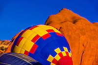Inflating hot air balloons, Red Rock Balloon Rally, Red Rock State Park, near Gallup, New Mexico USA.
