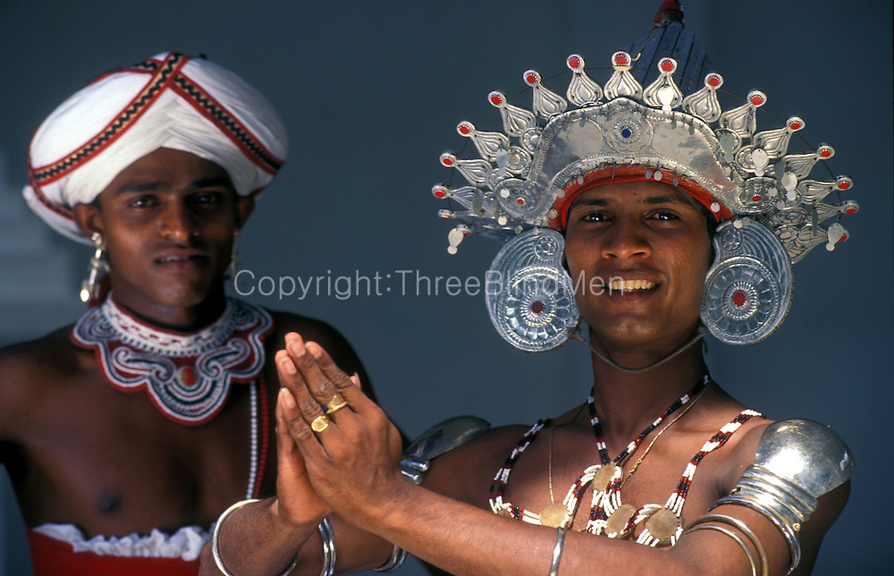 A Kandyan dancer in his costume.