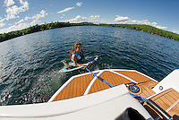 No waiting for that right wave for Claudia Cantin as she jumps into Lake Winnisquam for a wake surfing run behind her family's boat.  (Karen Bobotas/for the Laconia Daily Sun)