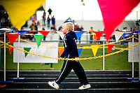 JEROME A. POLLOS/Press..Blaine Buckingham, from Skyway Elementary, walks through the finishing area after completing his race with fellow kindergarten students.