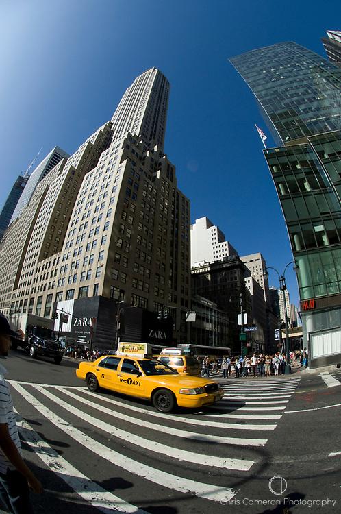 Fisheye lens view of a Taxi on a pedestrian crossing, 5th Avenue, Manhattan, New York City.