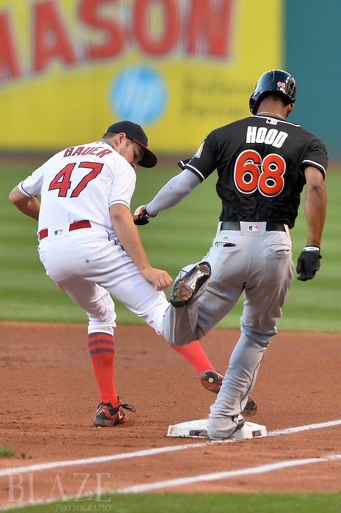 Sep 3, 2016; Cleveland, OH, USA; Cleveland Indians starting pitcher Trevor Bauer (47) forces out Miami Marlins left fielder Destin Hood (68) during the first inning at Progressive Field. Mandatory Credit: Ken Blaze-USA TODAY Sports