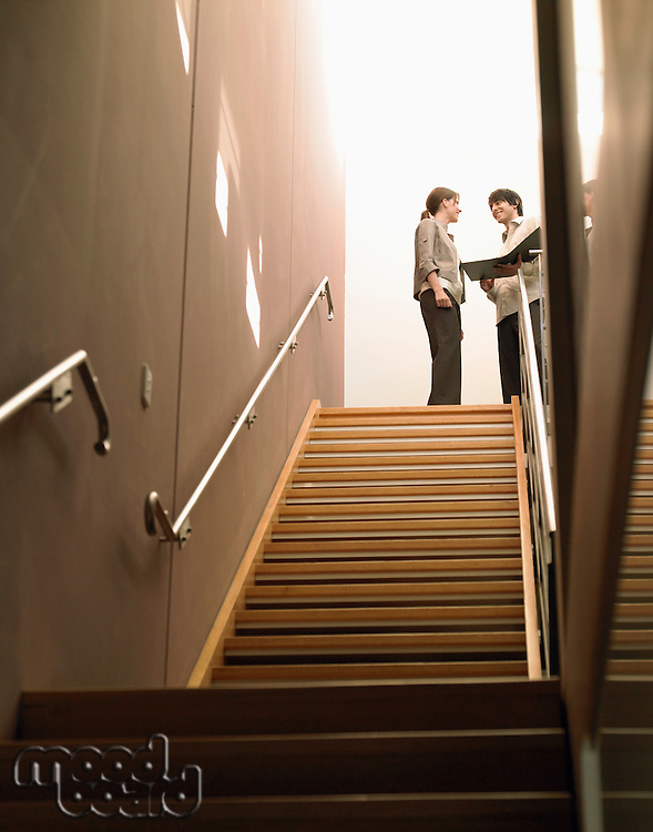 Businesspeople at Top of Stairs