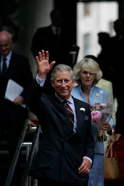 Prince and Duchess of Cornwall emerge from London's lloyds building after a visit..