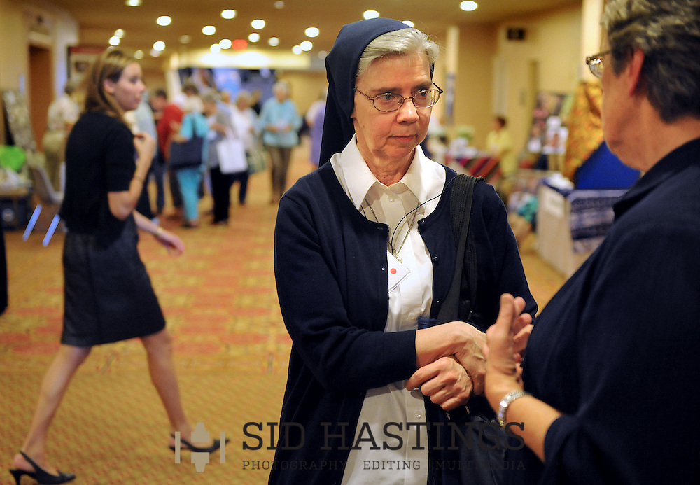 8 AUG. 2012 -- ST. LOUIS -- Sister Kathleen Appler (left), DC, and SIster Louise Gallahue, DC, talk during a break in presentations at the 2012 Leadership Conference of Women Religious (LCWR) Assembly in St. Louis Wednesday, Aug. 8, 2012. Photo @ copyright 2012 Sid Hastings.