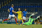 AFC Wimbledon Midfielder, Mitchell Pinnock (11) has a shot saved by Portsmouth Goalkeeper, Luke McGee (1) during the Carabao Cup match between Portsmouth and AFC Wimbledon at Fratton Park, Portsmouth, England on 14 August 2018.