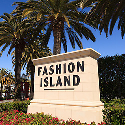 Photo of Fashion Island sign in Orange County California. Fashion Island is an upscale shopping mall in the affluent beach city of Newport Beach in Southern California. The photo is vertical, high resolution and was taken in 2012.