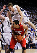 BYU guard Jackson Emery, top, falls on New Mexico forward Drew Gordon, bottom, as forward Noah Hartsock (34) also defends during the second half of an NCAA college basketball game in Provo, Utah, Wednesday, March. 2, 2011. New Mexico defeated 3rd ranked BYU 82-64. (AP Photo/Colin E Braley)