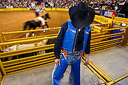 "15 DECEMBER 2002 - LAS VEGAS, NEVADA, USA: Bull rider Colby Yates, from Azle, TX, waits to competes in the 10th round of the National Finals Rodeo at the Thomas and Mack Center in Las Vegas, NV, Dec. 15, 2002. The NFR is the ""Super Bowl"" of rodeo. Only the top 15 cowboys in each event are invited to compete at the NFR, which runs for 10 days every Decemeber. All 10 performances of the NFR sell out every year. PHOTO BY JACK KURTZ"